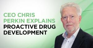 "Smiling man from the chest up on a light green background with the words ""CEO Chris Perkins Explains Proactive Drug Development"""