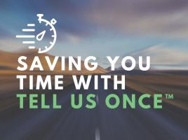 "Open road with the words ""Saving You Time With Tell Us Once"" written across in white and green."